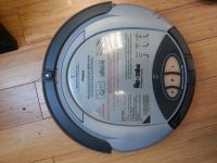 Roomba Robotic Cleaner Working with Charger